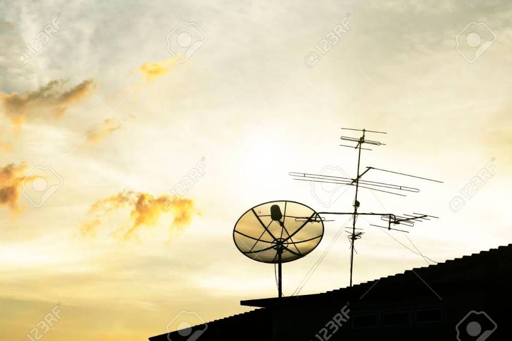 medium resolution of satellite dish in the morning sky stock photo 36994414