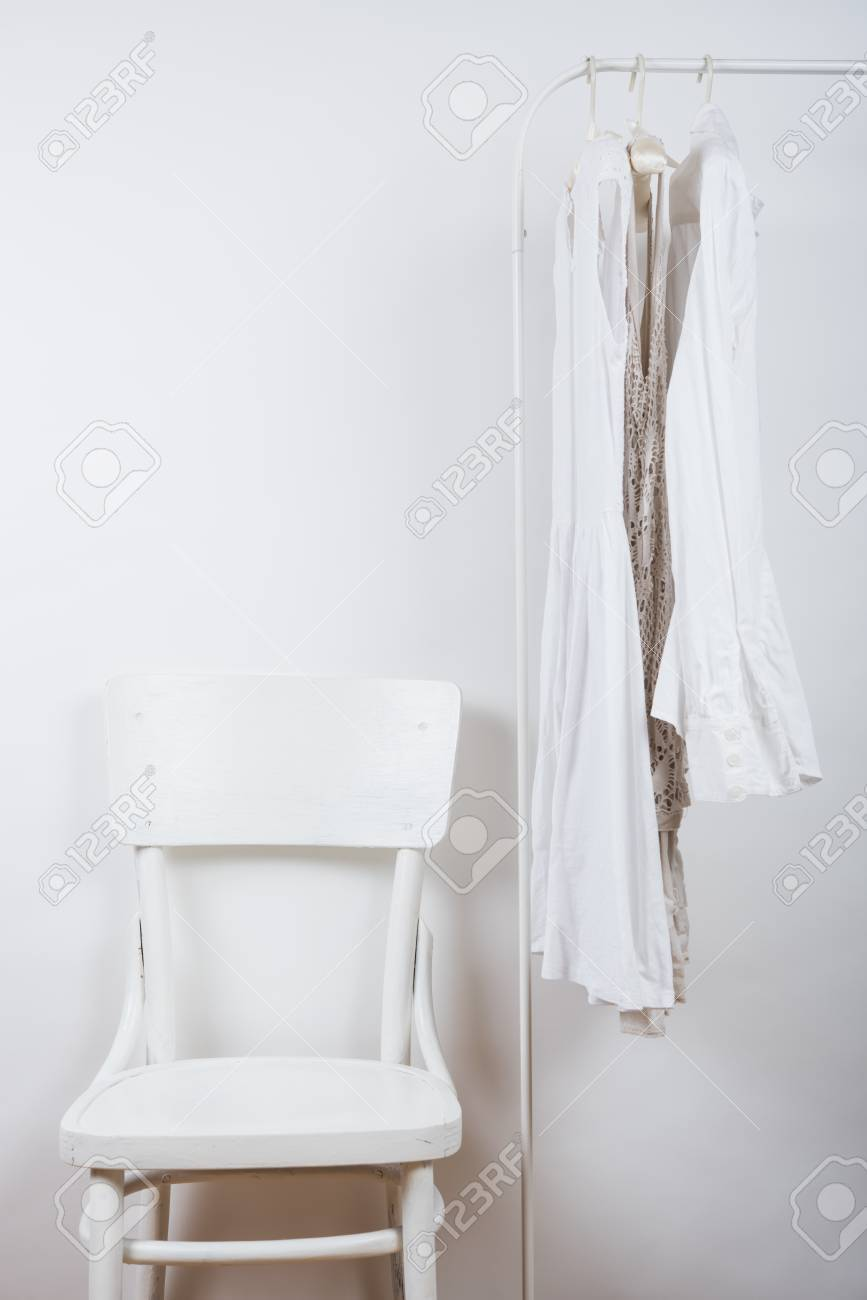 bedroom chair for clothes patio chairs canada lady s white interior on the hanger and vintage wall background
