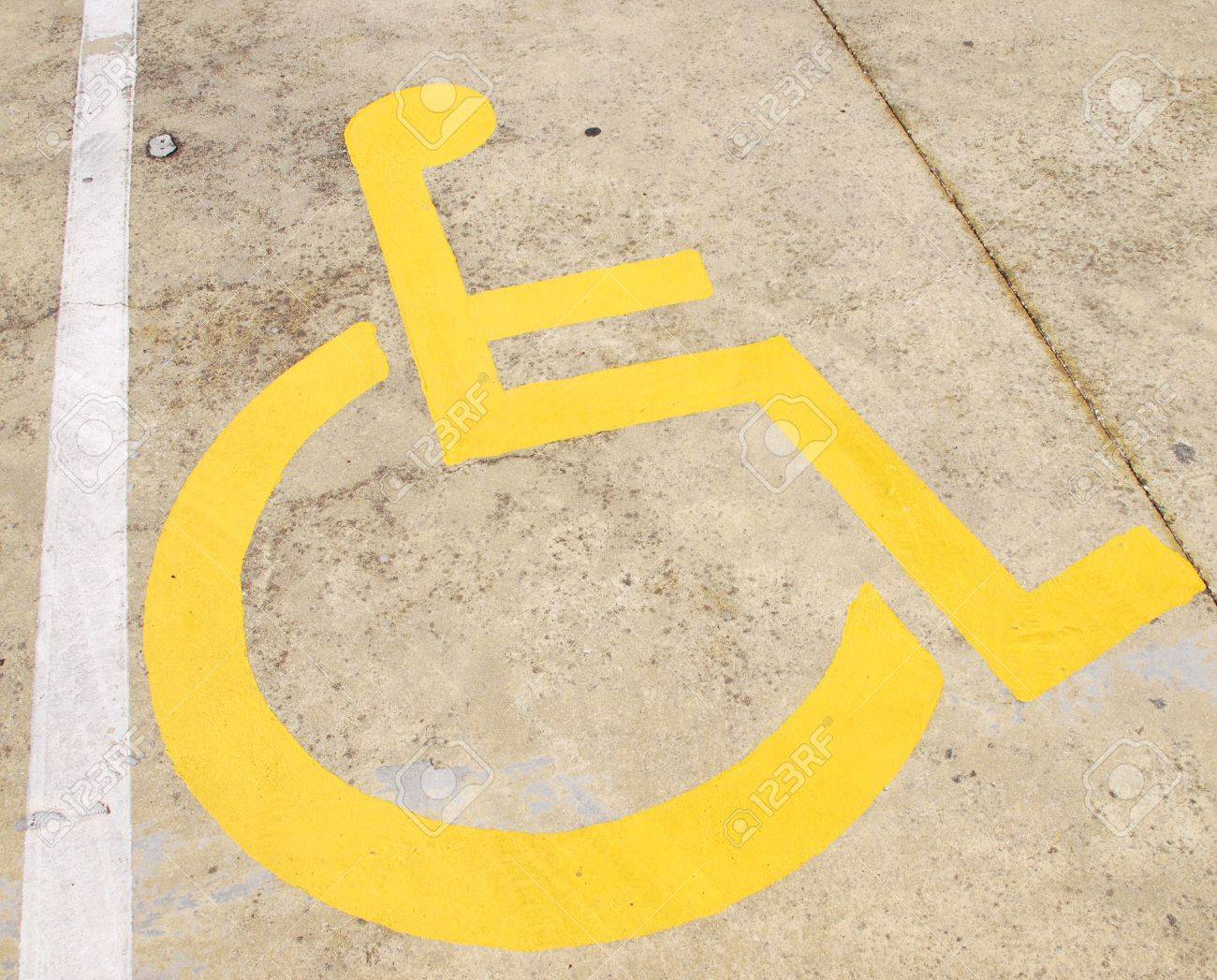 yellow wheelchair custom kitchen chairs handicap road sign painted on a pavement stock photo