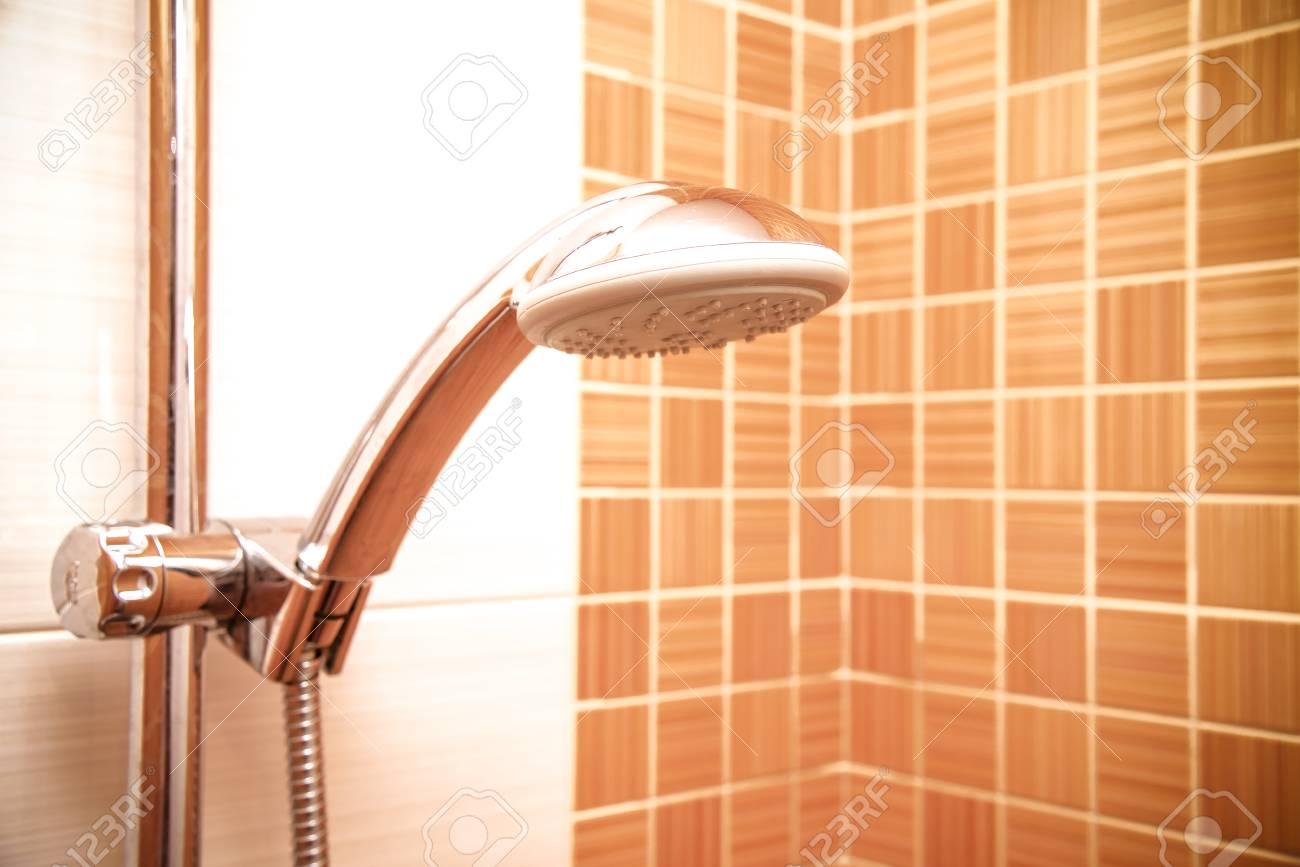 Closeup Of A Height Adjustable Shower Head In Modern Bathroom