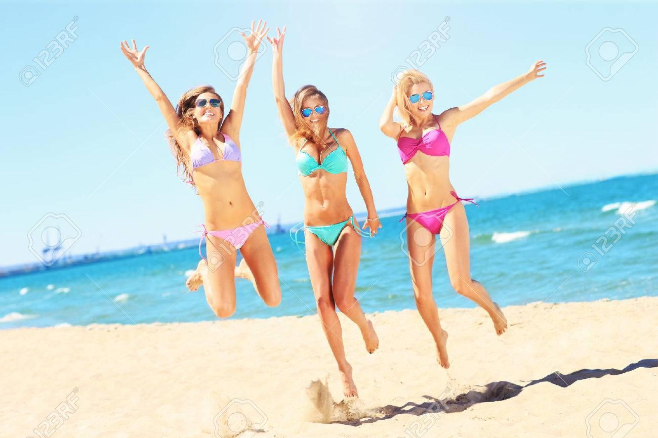 Group Of Sexy Women Having Fun On Beach Stock Photo 42869569