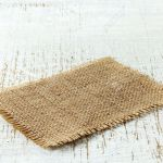 Burlap Napkin On Old Wooden Table Stock Photo Picture And Royalty Free Image Image 26924393