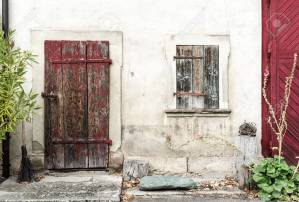 Old Rustic Vintage House Front With Massive Wooden Door And Window