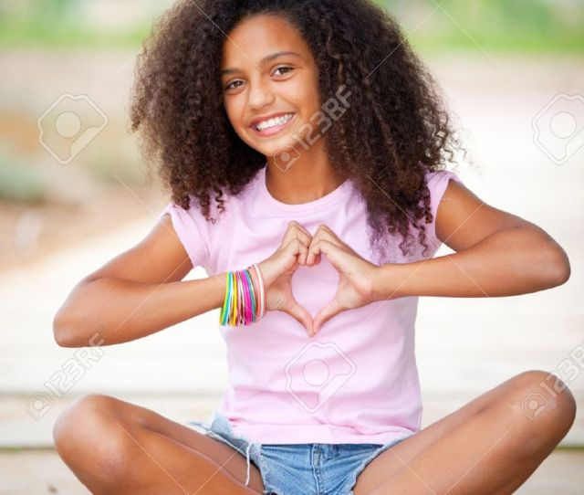 Stock Photo Young Happy Smiling African American Black Teen Girl With Afro Hair Making Heart Shape