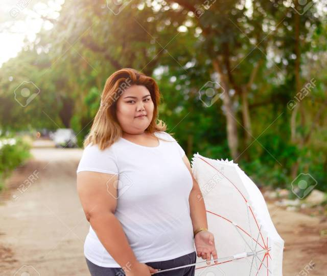 Portrait Asian Beautiful Fat Woman With Umbrella In The Garden Relax In The Garden