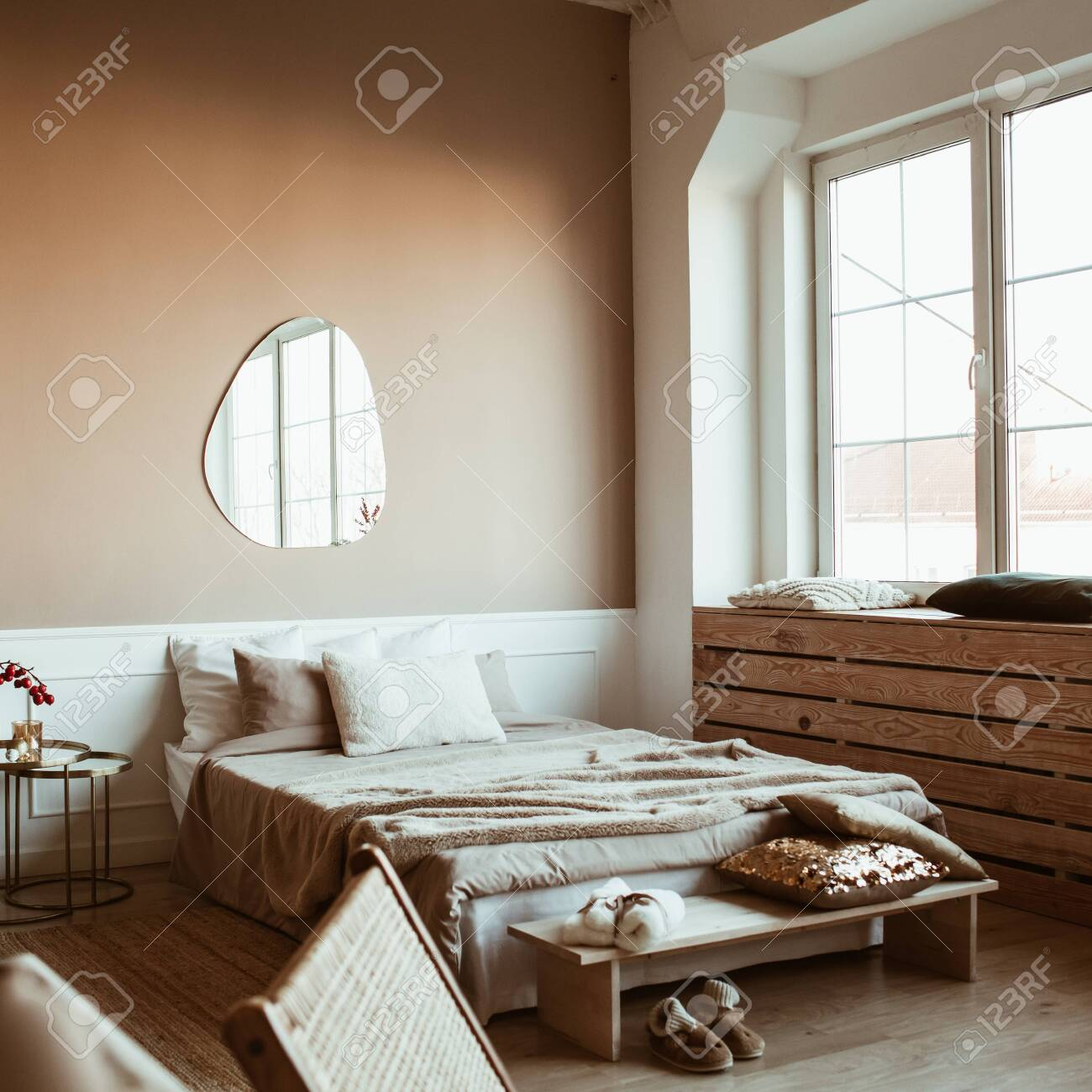 Stylish Beige Color Bedroom With Bed Linen Pillows Mirror Stock Photo Picture And Royalty Free Image Image 143860653