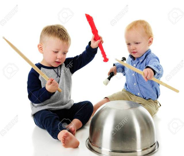 A Two Toddler Rhythm And Music Band Both Boys Hold A Recorder And Drumstick