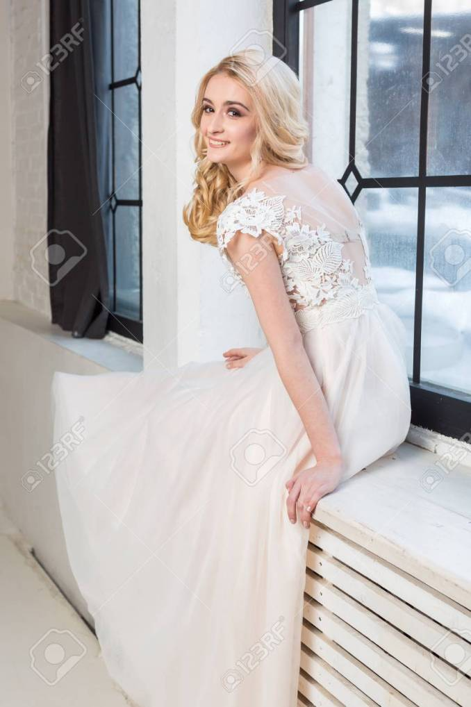 fashionable wedding gown, beautiful blonde model, bride hairstyle..