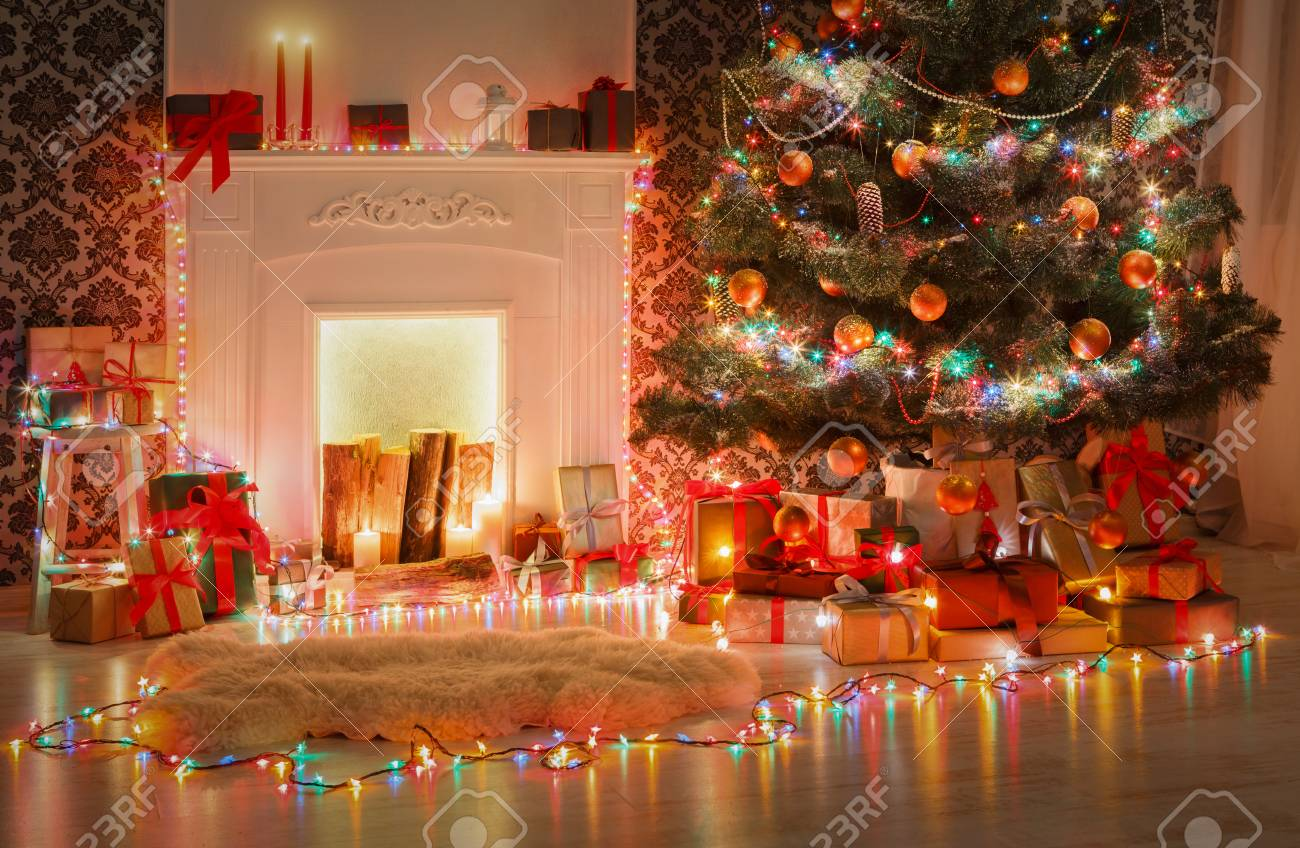 beautiful living rooms at christmas fabric swivel chairs for room decorations xmas lights garland decorated tree near fireplace