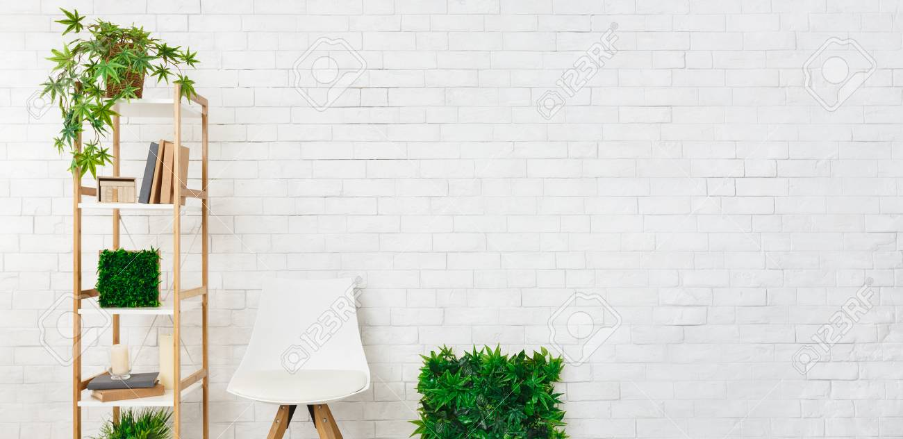 Scandinavian Chair Shelving With House Plants And Scandinavian Chair At White Brick