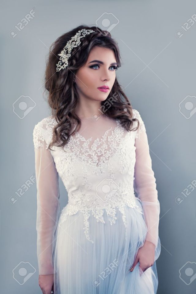 beautiful young woman wearing evening gown. perfect bride with..