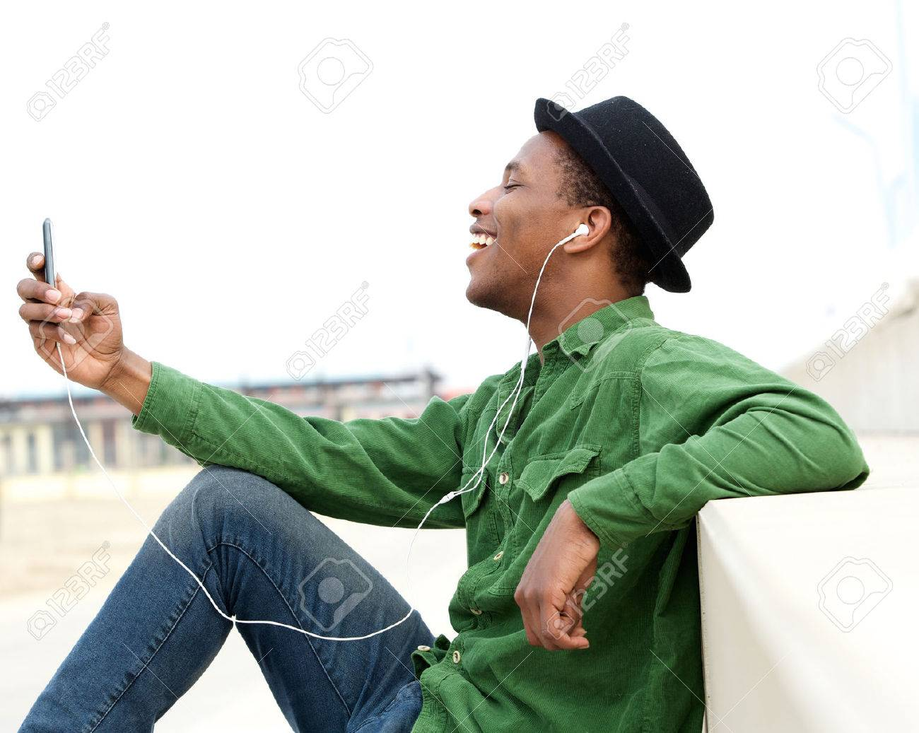 Image result for guy walking and listening to music