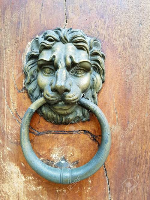 small resolution of antique brass door knocker in the shape of a lion s head with large ring in
