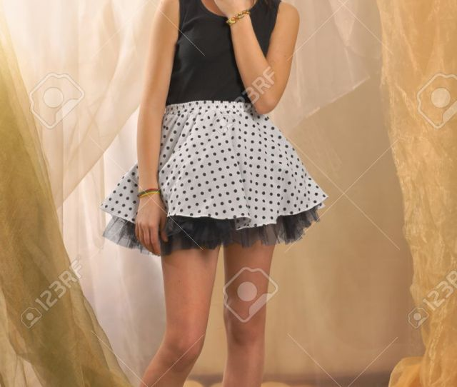 Stock Photo Teenager Girl In Standing Position Barefoot And Dressed In A T Shirt And Mini Skirt