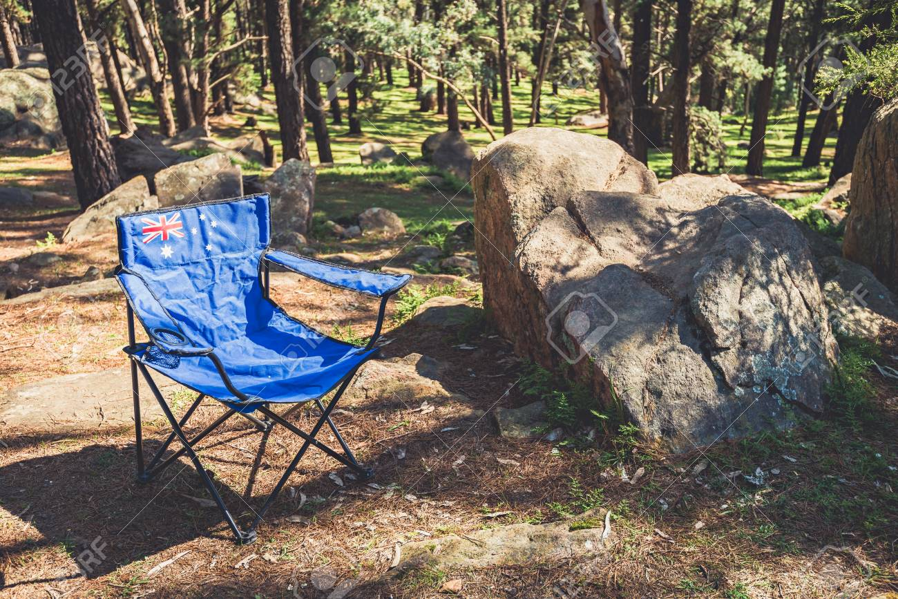 portable picnic chair low back beach chairs 9 or less with australian flag in mount crawford stock forest reserve on australia day photo