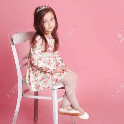 Baby Girl Chair Dining Table And Chairs Argos Cute 4 5 Year Old Sitting On White Over Pink Stock In Room
