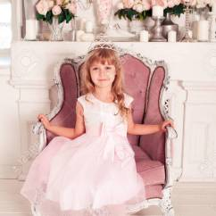 Baby Girl Chair Cover Hire Gumtree Beautiful 5 6 Year Old Celebrating Birthday Sitting On In Room