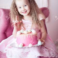 Baby Girl Chair Living Room Chairs Uk Smiling 4 5 Year Old Holding Birthday Cake Sitting Stock In