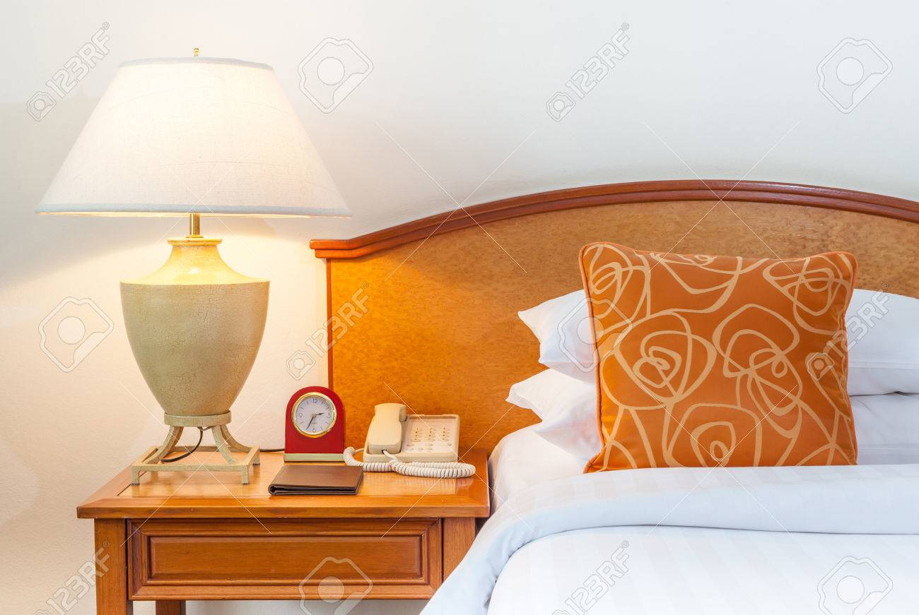 Hotel Room Setting With King Sized Bed Thai Silk Orange Pillow