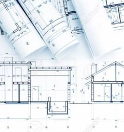 home plans and blueprint rolls with drawing compass on desk stock photo 57394848 [ 1300 x 866 Pixel ]