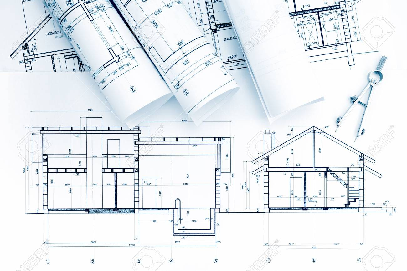 hight resolution of home plans and blueprint rolls with drawing compass on desk stock photo 57394848