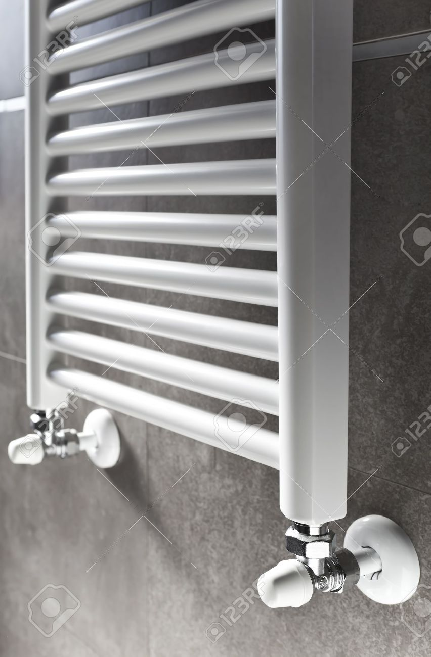 white bathroom heater closeup on gray wall stock photo, picture