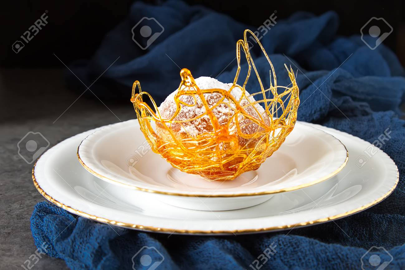 Italian Dessert Is Profiterole With Cream And Caramel Decoration