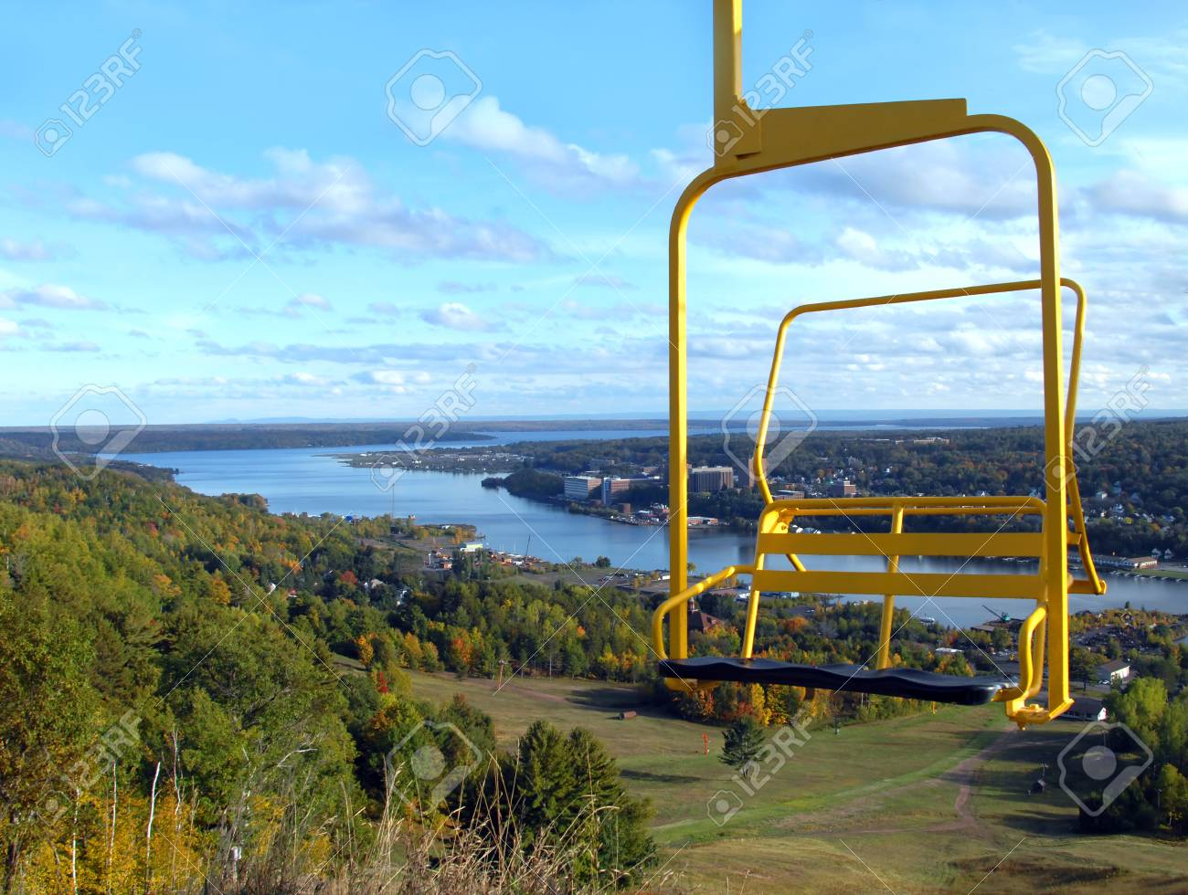 high lift chair office with coccyx cut out yellow ski sits above the houghton michigan stock photo landscape in distance building of tech are seen