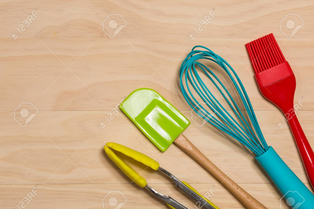 Colorful Kitchen Tools On Wooden Background Stock Photo Picture And