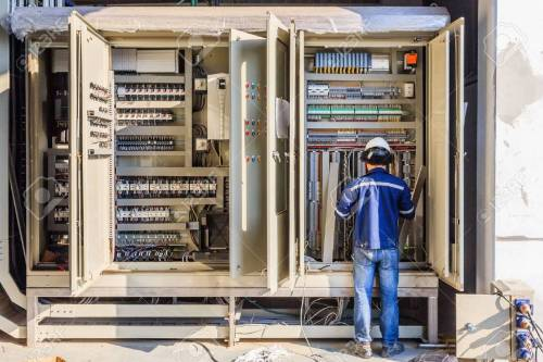 small resolution of instrument technician on the job check wiring on plc cabinet stock photo 72727658
