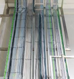 stock photo the electrical wiring of building a cable tray system used to support insulation electrical cables  [ 1300 x 866 Pixel ]