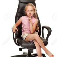 Little Girl Chairs Swivel Living Room Young Sitting On A Chair Stock Photo Picture And Royalty Free