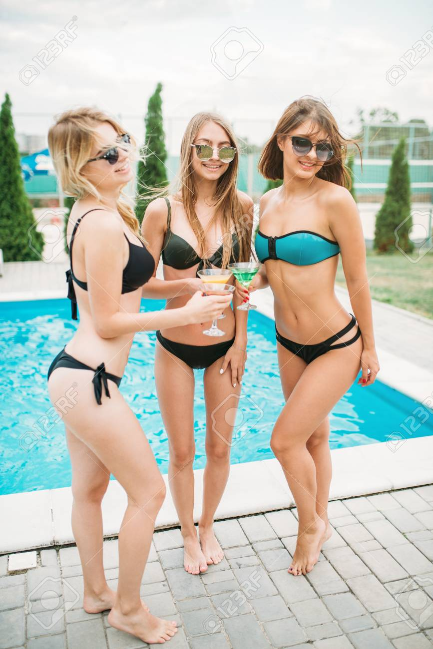 Sexy Girls Drinks Cocktails Near The Swimming Pool Stock Photo 86055058