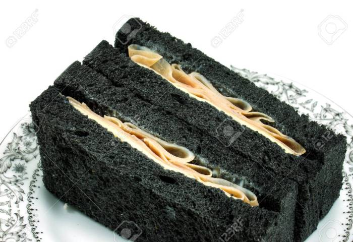 Black Bread Sandwich With Ham And Cheese Stock Photo Picture And