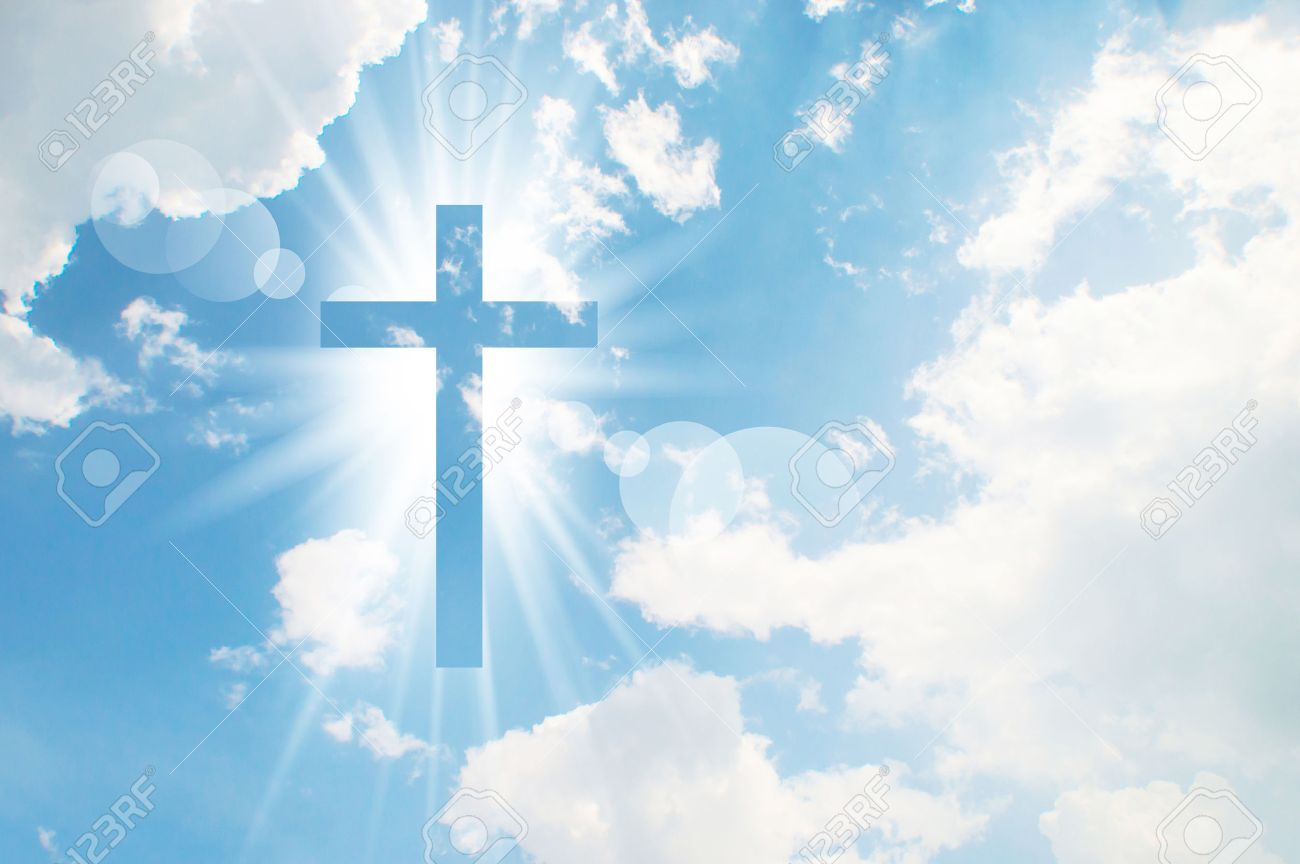 Christian Cross Appears Bright In The Sky Background Stock Photo Picture And Royalty Free Image Image 73765891