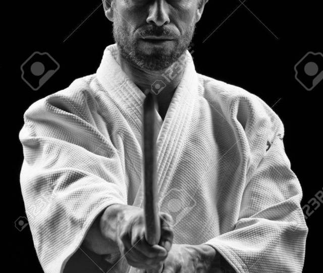Low Key Portrait Of Aikido Master With Wooden Sword Stock Photo
