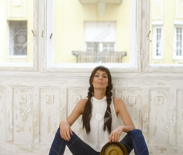 Pretty Casual Woman Sitting On Floor Front Of Window Legs Wide Open Stock Photo