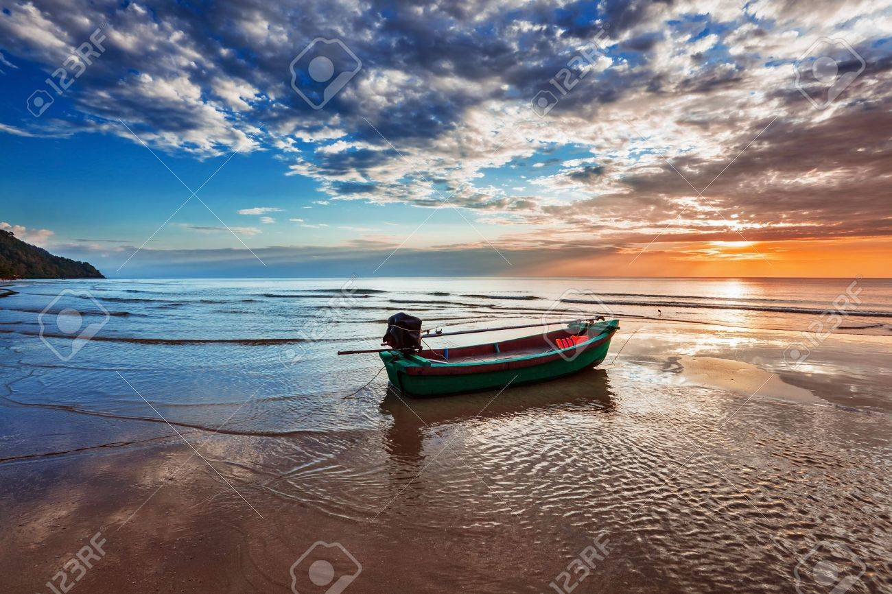 boat on the beach at sunset in tide time stock photo, picture and