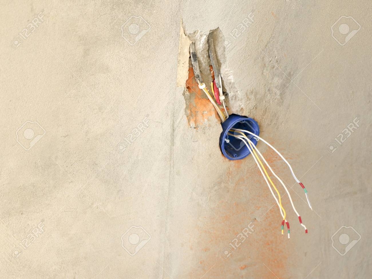 hight resolution of stock photo wall socket installation work on installing electrical outlets electrician prepares wiring fitting outlets