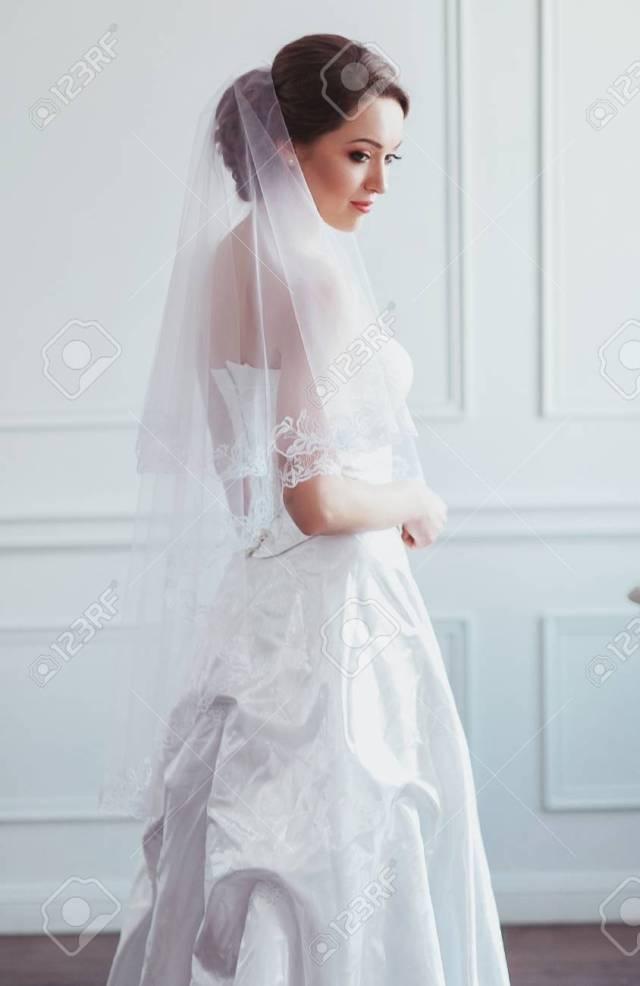 beautiful bride with fashion wedding hairstyle - on white background