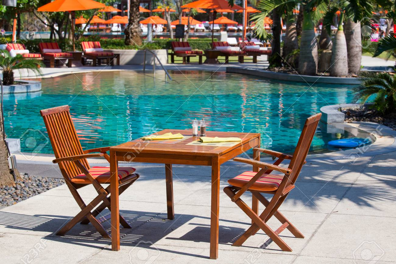Chairs For Pool Table And Chairs In Empty Cafe Next To The Pool Thailand