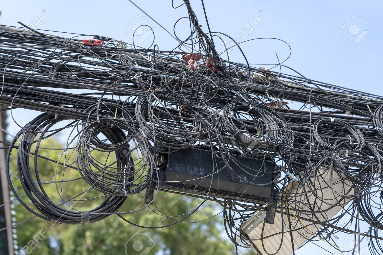 hight resolution of many electrical cable wire and telephone line on electricity post thailand wire and cable clutter potential danger from a mess of wires