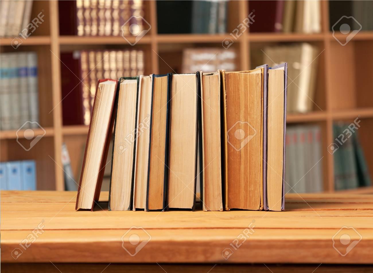 vintage books on wooden