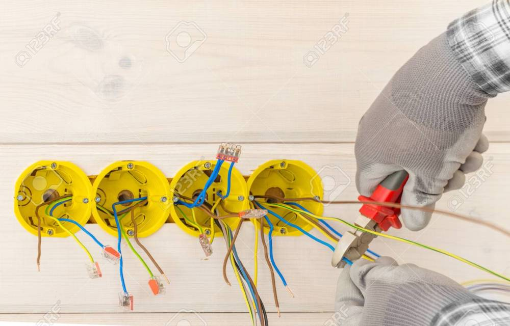 medium resolution of hands of electrician installing electrical socket with screwdriver in the wall stock photo 104654914