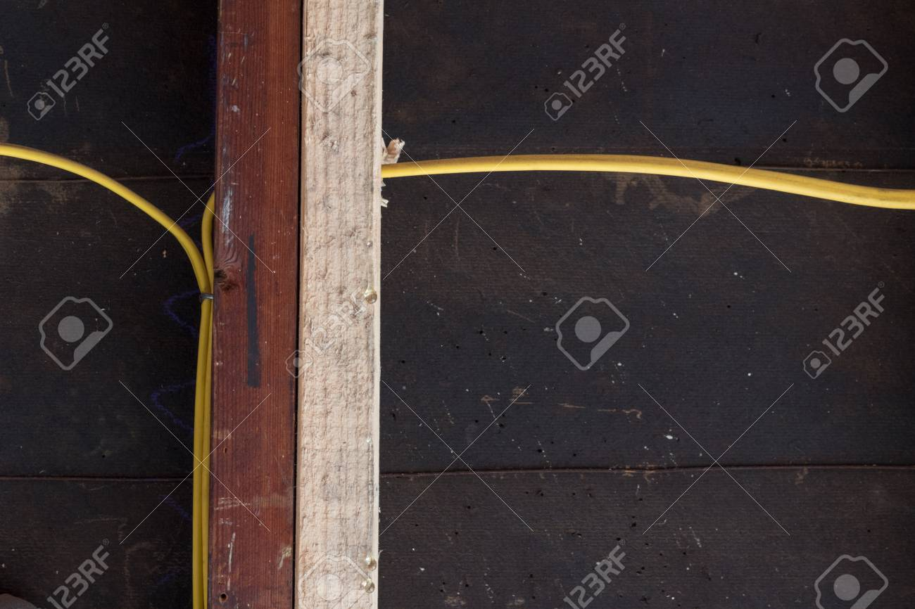 hight resolution of stock photo straight view of sistering of old and new wall studs for structural support yellow electrical wiring against construction felt copy space