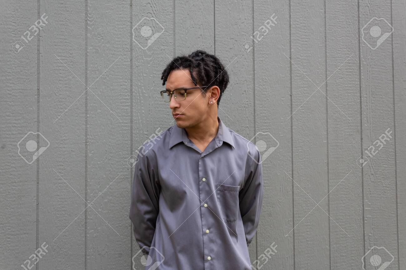 Young Man Facing Camera With Head Turned Looking Down African