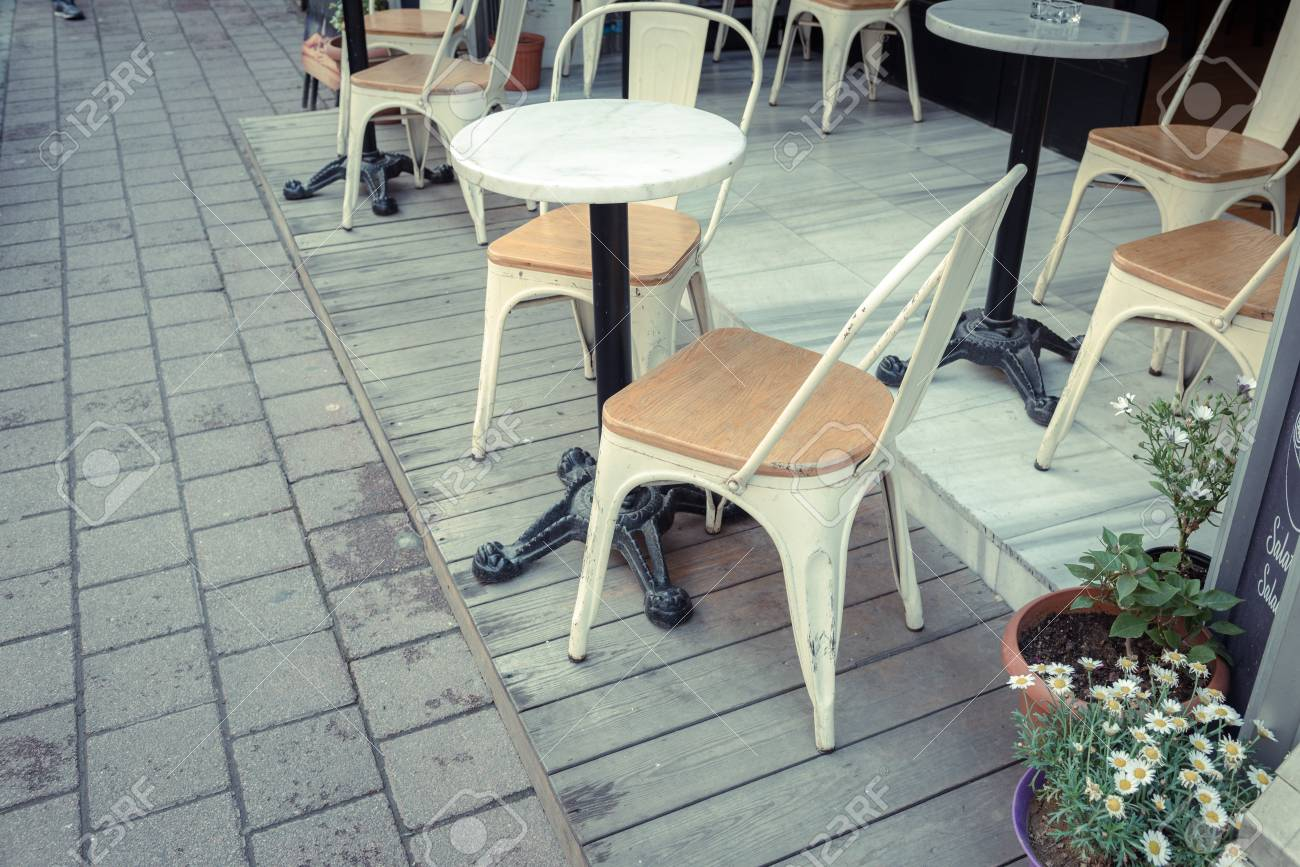 retro cafe table and chairs revolving chair handle vintage view of pastel tables wild daisy pot on