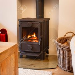 Cosy Living Room With Log Burner Shades Of Orange Paint For Cozy Modern Interior Wood Stock Photo 15812377