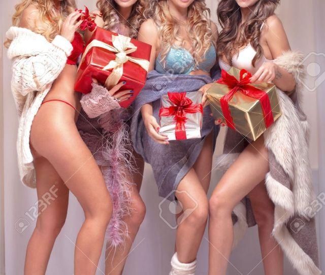 Beautiful Sexy Group Of Santa Girls Ladies Holding Christmas Gifts Stock Photo