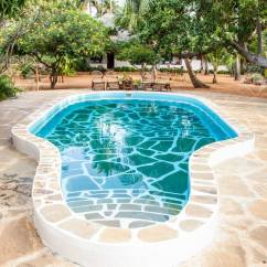What Are Pool Chairs Made Out Of Plastic Patio Chair Kenya Luxury Swimming In African Garden With Tipical Local Wood On